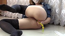 Blonde in stockings on the floor fucks anal and pink pussy, fingering and sex toys in holes.