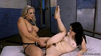 Young petite brunette slave anal toys herself then big tits blonde domme toys and fucks her with strap on cock