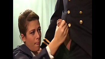 French stewardess Alyson Ray gives pilot some head after landing the aircraft at the airport WC