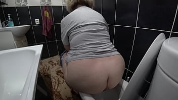 The husband has installed a hidden camera in the toilet room and spies on a chubby milf who urinates while sitting on the toilet