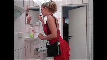 A cute and naive blondie is buggered in a toilet
