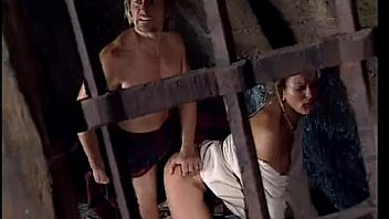 Woman a. in cell by jailer in front of her tied up husband