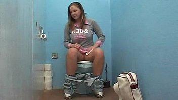 German Denisa screws in the toilet of a petrol station